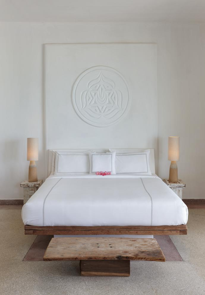 The furniture and even the lamps in this bedroom in the Presidential Villa were made by local craftspeople. The symbol of the sacral chakra above the bed is one of the decorative motifs used throughout the resort.