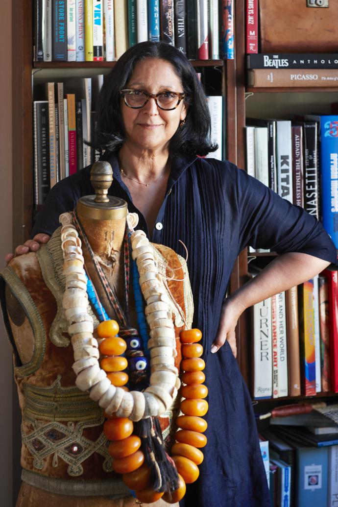 Juditha with a dressmaker's dummy – a gift from her cousin Briana – bedecked with strings of amber beads and conus shells from Mali and an evil-eye talisman.