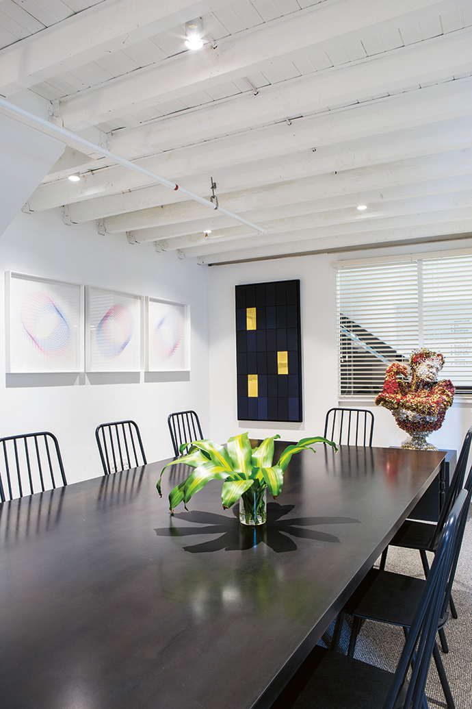 The boardroom, which is also available for non-members to book for the day, features a table and chairs by Gregor Jenkin, screenprints by Paul Edmunds and a bust by Athi-Patra Ruga. The artwork in Tiny Empire is from Justin's personal collection or from WHATIFTHEWORLD, and will be on rotation.