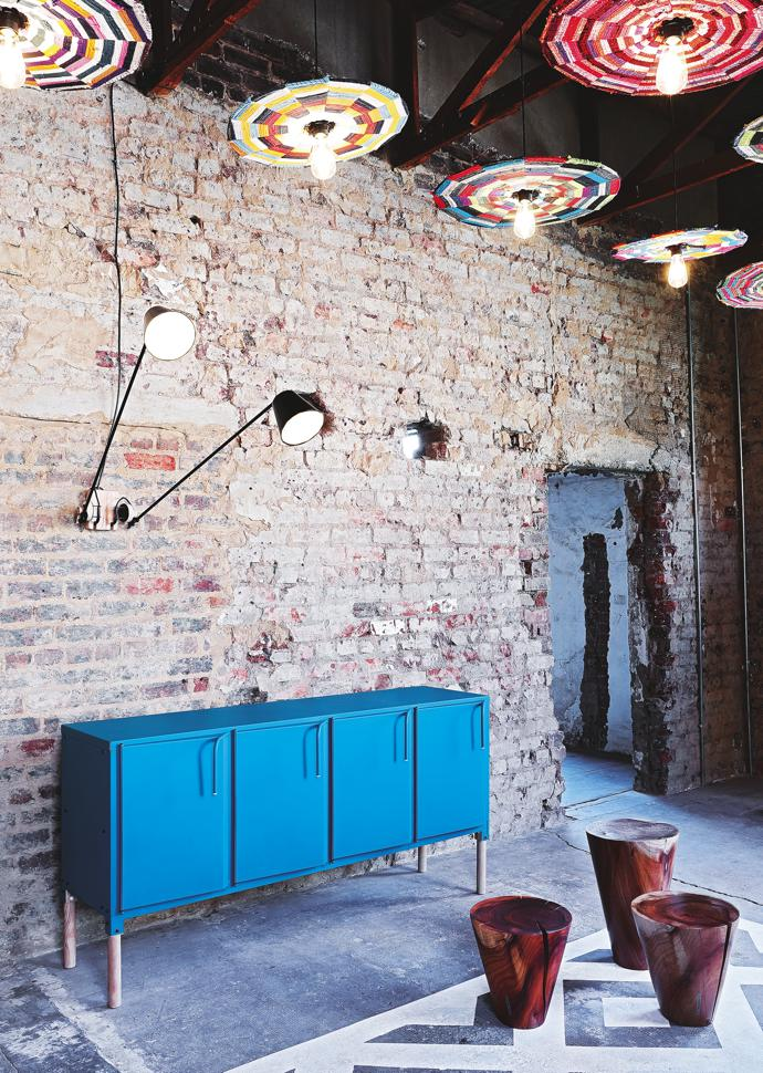 Lampshades by Ashanti Design, wall lamps by David Krynauw, server by Dokter and Misses and stools by Frank Böhm Studio, all part of an installation by Tin Lab.