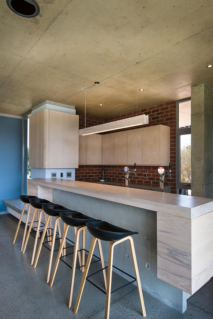 In the bar area downstairs, raw brick provides a warm contrast to concrete, ash and terrazzo. The bar stools are by Rolf Benz.