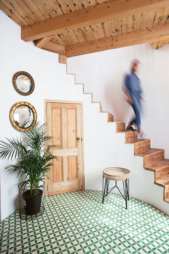 A staircase with Oregan-pine treads hugs the curve of the wall up to the bedroom.