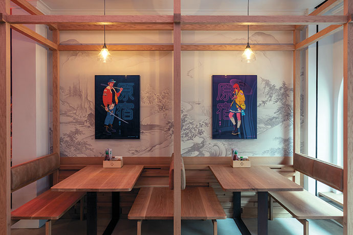 Terence Kitching's illustrations of a Harajuku boy and girl adorn a wall at Tjing Tjing Torii.