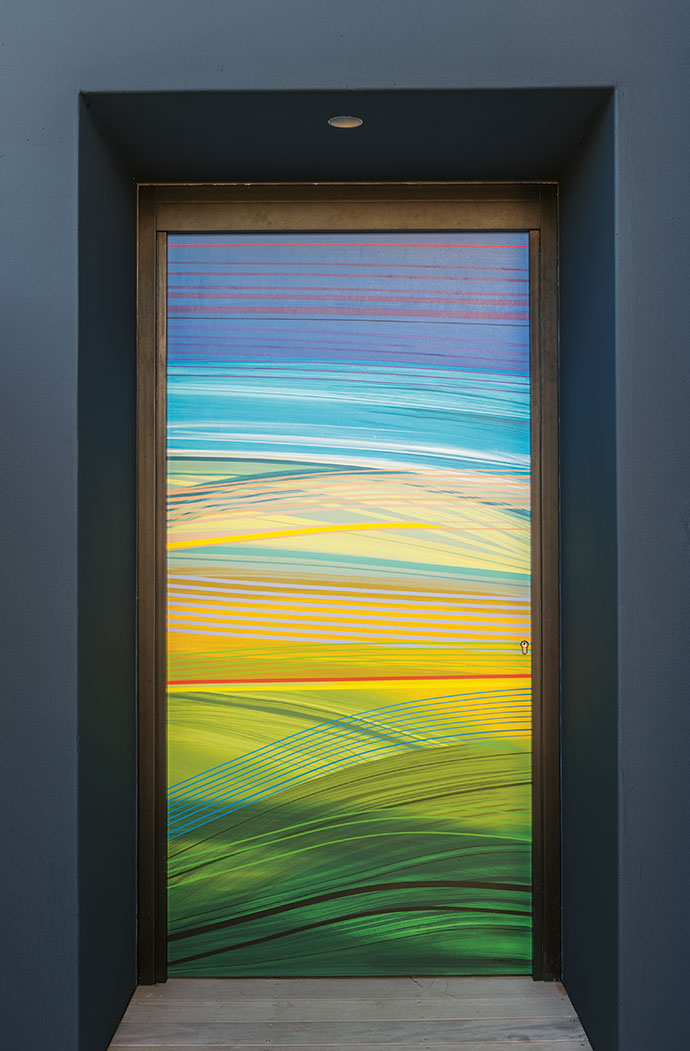 The front door by artist Paul Blomkamp depicts a land and seascape.