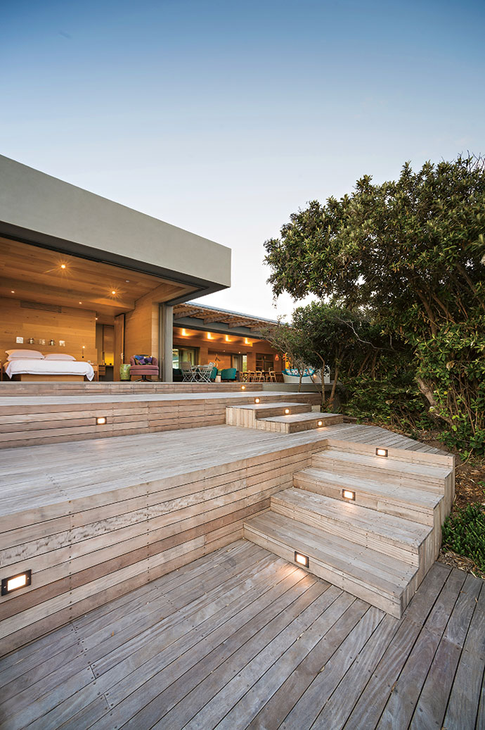 The decking and screens were done by Top Deck. The timber used is South American garapa hardwood. In the background are the main bedroom and main living area.