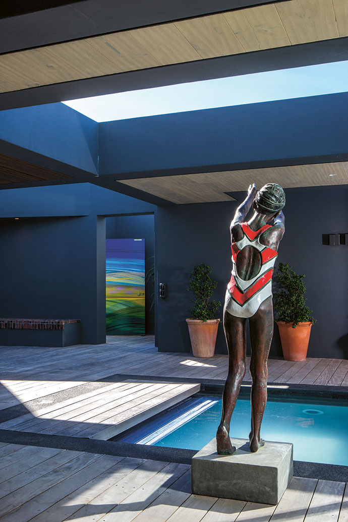 Another sculpture by Marieke Prinsloo-Rowe, Trying to Catch the Dream, looks ready to dive into the splash pool.