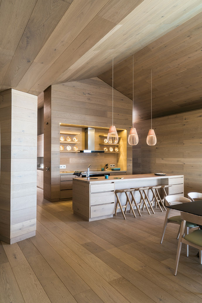 The open-plan kitchen has both sea and mountain views. The joinery throughout the house was done by Engton Cupboards.