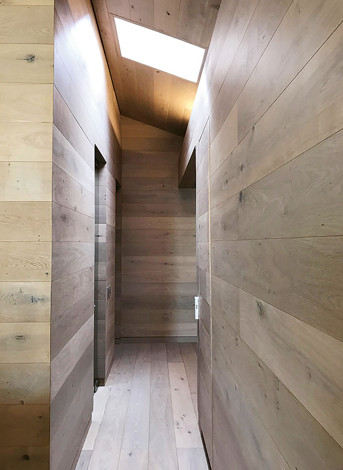 """Wide-plank oak from Oggie was used for the cladding throughout the house. """"We followed the roof angle inside to create more space,"""" says Johann. """"This created the interesting angles where the ceiling meets the wall planes."""""""
