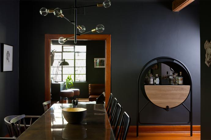 The molecule pendant light above the dining room table (which is from James Mudge Furniture Studio) is from Eleven Past. The chairs are from Houtlander and Gregor Jenkin, and the drinks cabinet is by Jo Paine.