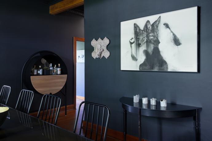 The artwork above the Gregor Jenkin half table is by Peter Mammas (left) and Kobus Rossouw (right).