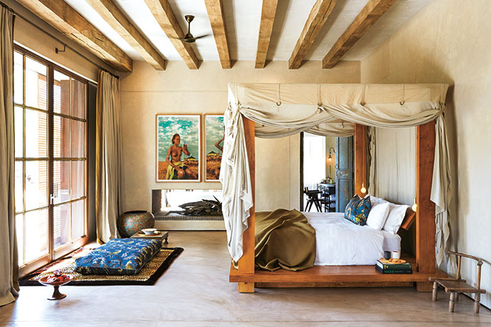 The bed is by Donna Karan with a custom mosquito net. Lee Broom pendants offer the perfect reading light. The artworks are Xhosa Woman – Intombi I and II by Tony Gum. In front of the sliding door is a meditation area overlooking the bush.