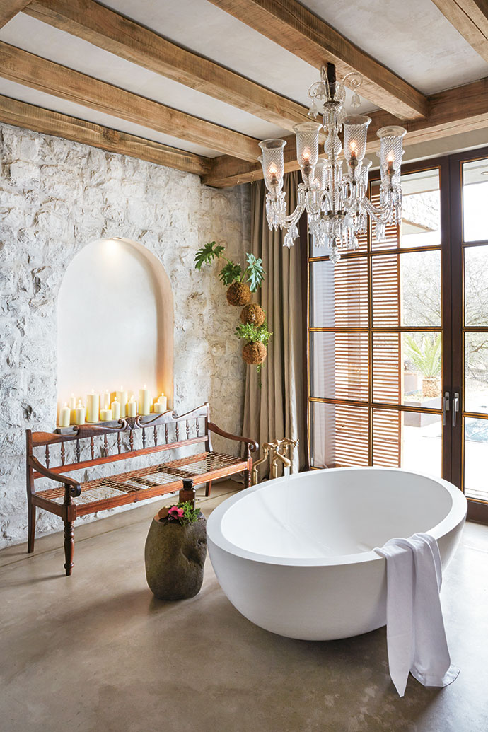 This light-filled bathroom overlooks the private pool and waterhole. Baths were made to the owners' specifications.