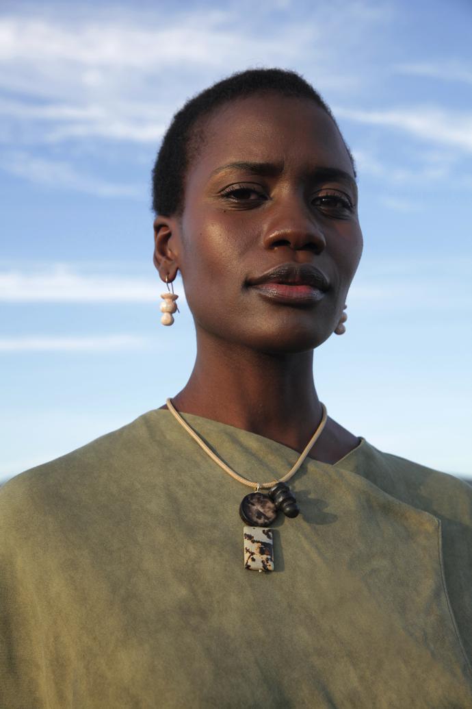 Model Patricia Laloyo wears Chess Hook earrings, Chess and Stone pendant and #pichulikbynadya.