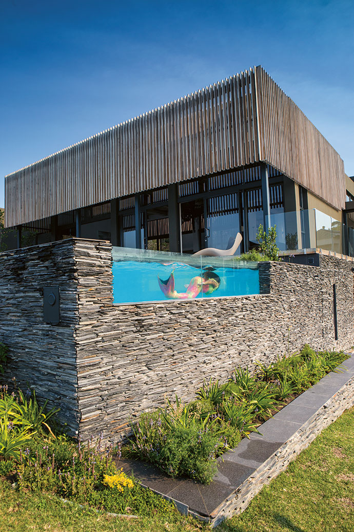 The wooden screen and drystone retaining wall contribute to how well the building nestles into the topography.