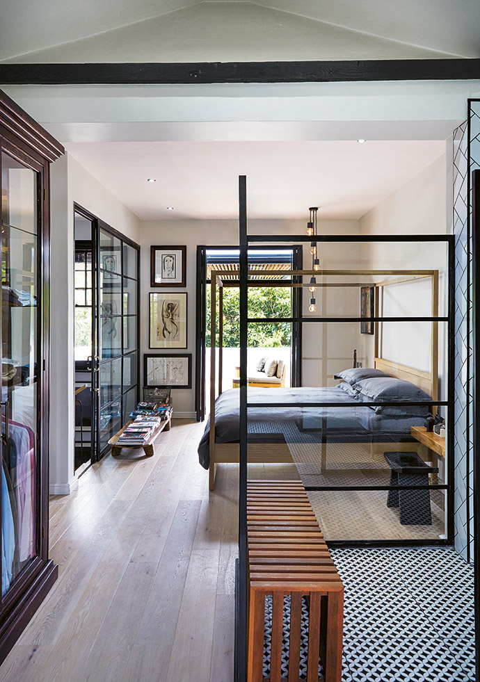 The couple's bedroom, where they've hung some of their favourite monochromatic artworks, opens onto a balcony that affords stunning views of the city.