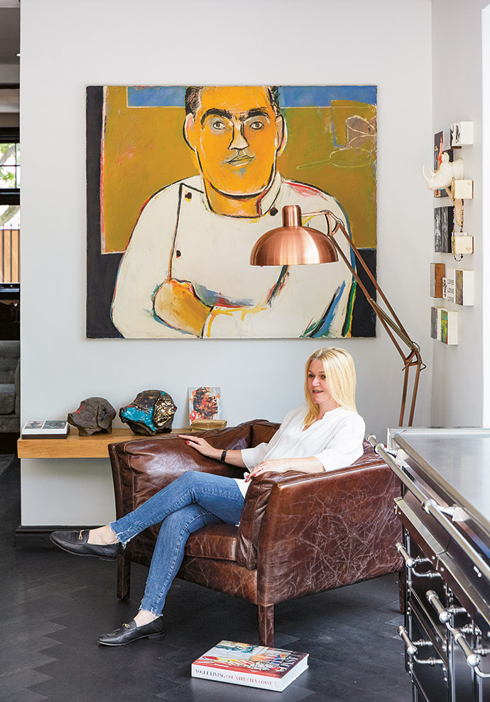 Behind Jan is a portrait of Liam from his BANC restaurant days in Sydney.