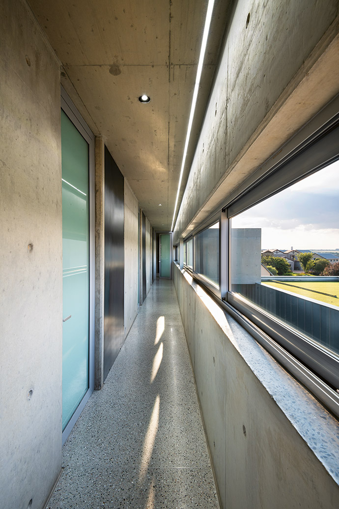 The balau footpath is echoed by a concrete roof overhead and framed by Artevia concrete paving.