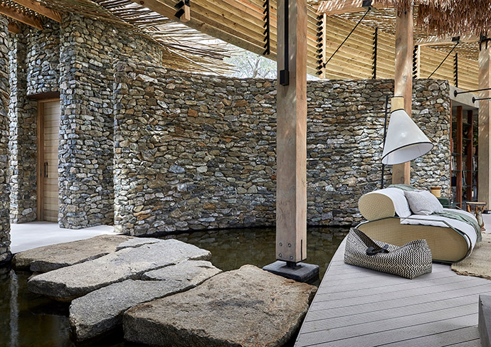 SRLC Architects' vision was realised by Ingwe Construction – a feat in the middle of nowhere! – including the stone work. The Lesley Light and B-couch, with steel arms and rattan side panels, were both designed by SRLC Architects.