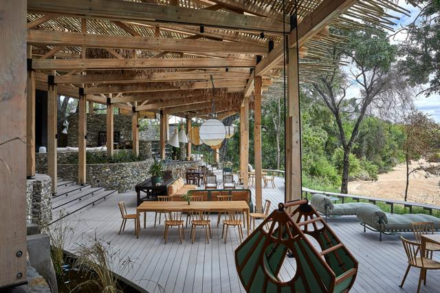 The hanging chair is from David Krynauw, the large table from Andrew Dominic Furniture, and the rattan and rice paper mobile was made by Luke Carstens.