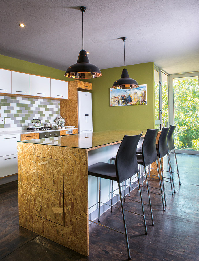 The kitchen island – also made of oriented strand board – doubles as a dining table, saving considerable space.