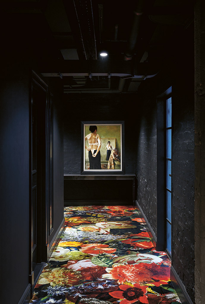 A Moooi carpet, a Gregor Jenkin desk and an oil painting by Diane McLean, The Black Skirt, in a hallway.