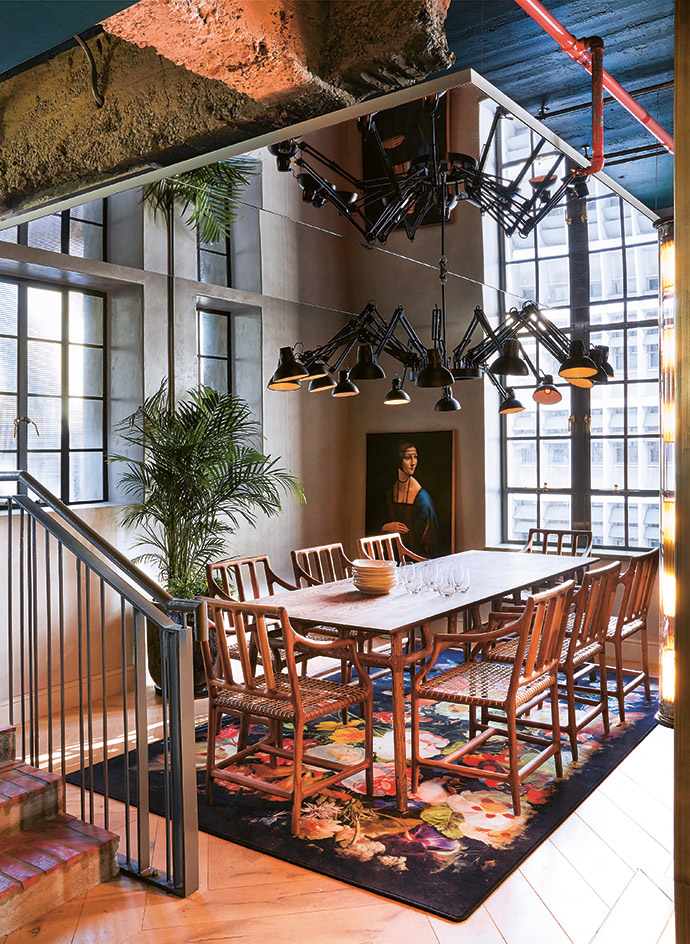 At Gigi Rooftop, the open-plan dining area invites guests to make themselves at home. The table and chairs are designed by David Krynauw, the carpet and Dear Ingo pendant light are by Moooi, and the artwork is by Zhenya Li.