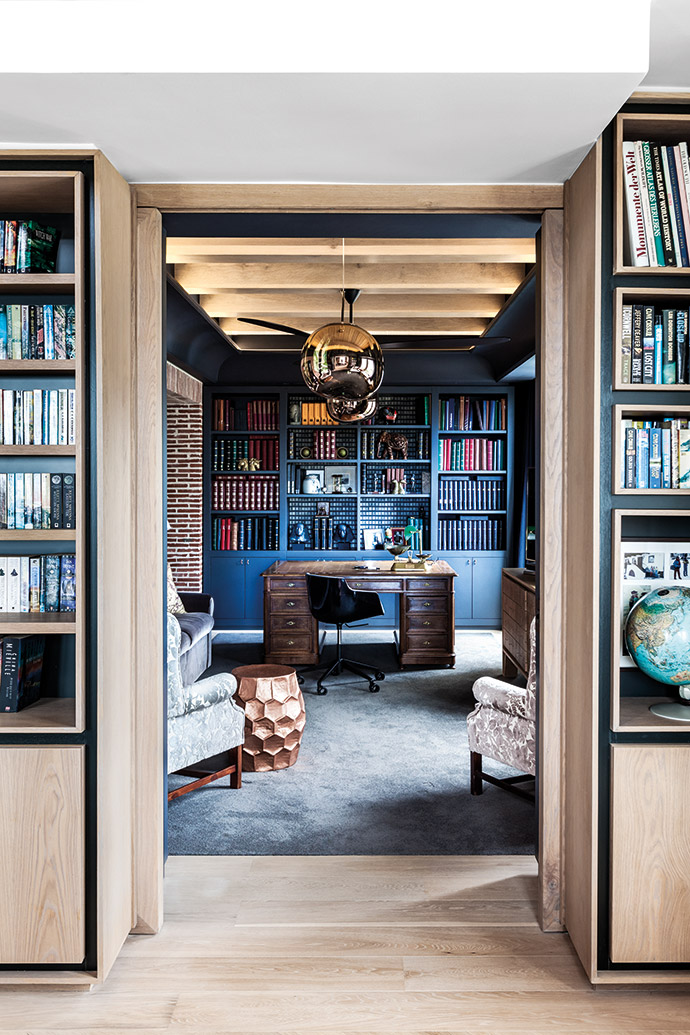 A blue-grey palette warmed up with woods and splashes of copper and gold makes the stamp room a luxurious bolthole. The wallpaper is from St Leger & Viney and the Tom Dixon Melt pendant lamps are from Créma. The Flow Slim chair, a Jean-Marie Massaud design, is from Limeline.