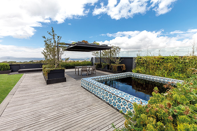 The water-wise garden offers an uninterrupted view spanning from Sea Point to the harbour, and a pool decorated with tiles from World of Decorative Concrete.
