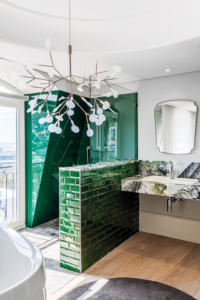 Tiles in a punchy green (from Douglas Jones) and grey-and-green Monet marble (from WOMAG) echo the verdant shades of Green Point Urban Park, which the apartment overlooks.
