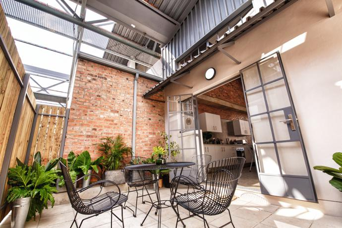 2 bed loft – Private outdoor terrace leading from kitchen and dining area.