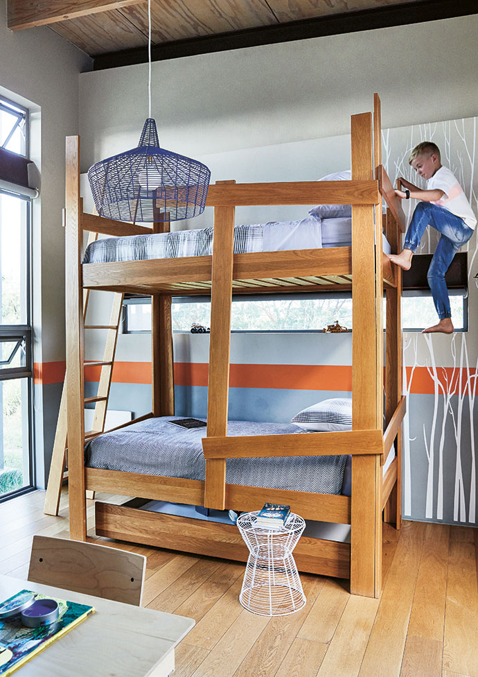 The bunk bed in Noah's room, which Gillian designed, is inspired by tree trunks and a forest setting. The desk and chair are by Pedersen + Lennard.