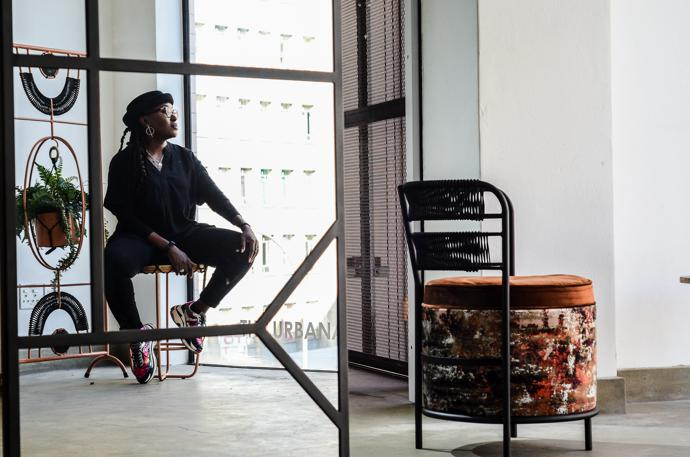Mpho Vackier with her Oromo chair and Ziyanda mirror photographed by Lutendo Malatji for VISI Issue 104, 2019.