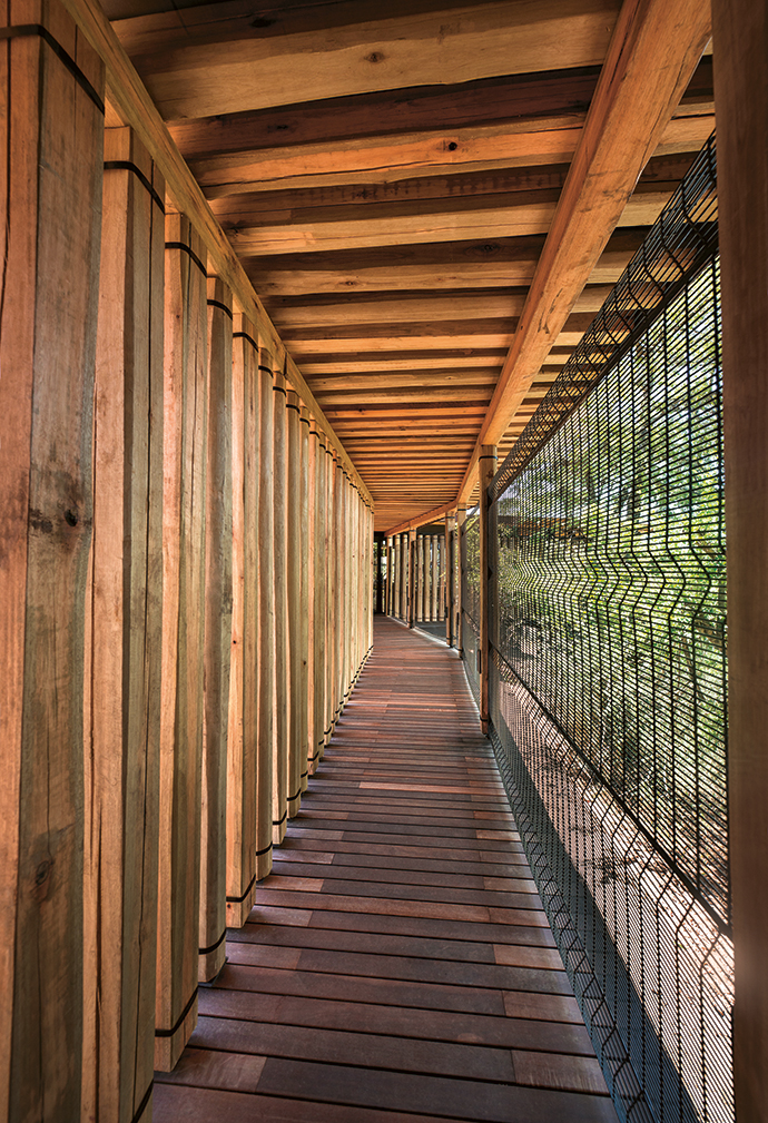 Two guest suites can be linked via this passage to create a family unit. The steel ClearVu fence provides a sense of being outside in the bush yet safe, and both exposed and private. The external timber cladding comes from old railway sleepers, referencing the erstwhile Selati Railway Line.