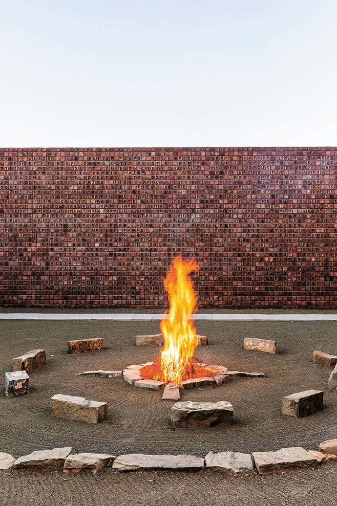 Fireplace by Strijdom van der Merwe, and Word Woes by Willem Boshoff, 2018, wall with alphabet bricks (a MAPSA outreach collaboration with local brickmaker Trevor Snyders).