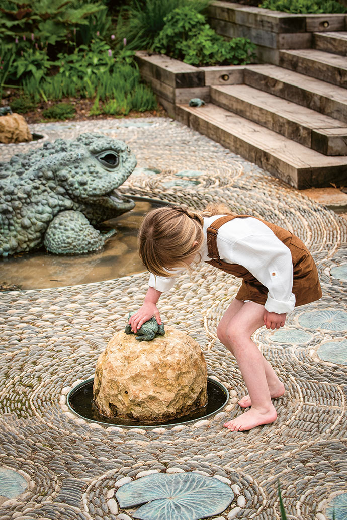 In the modern water garden, children delight in bronze fairy-tale frogs in various sizes that unexpectedly squirt water. The stone mosaic was created by a talented contractor working at The Newt during construction.
