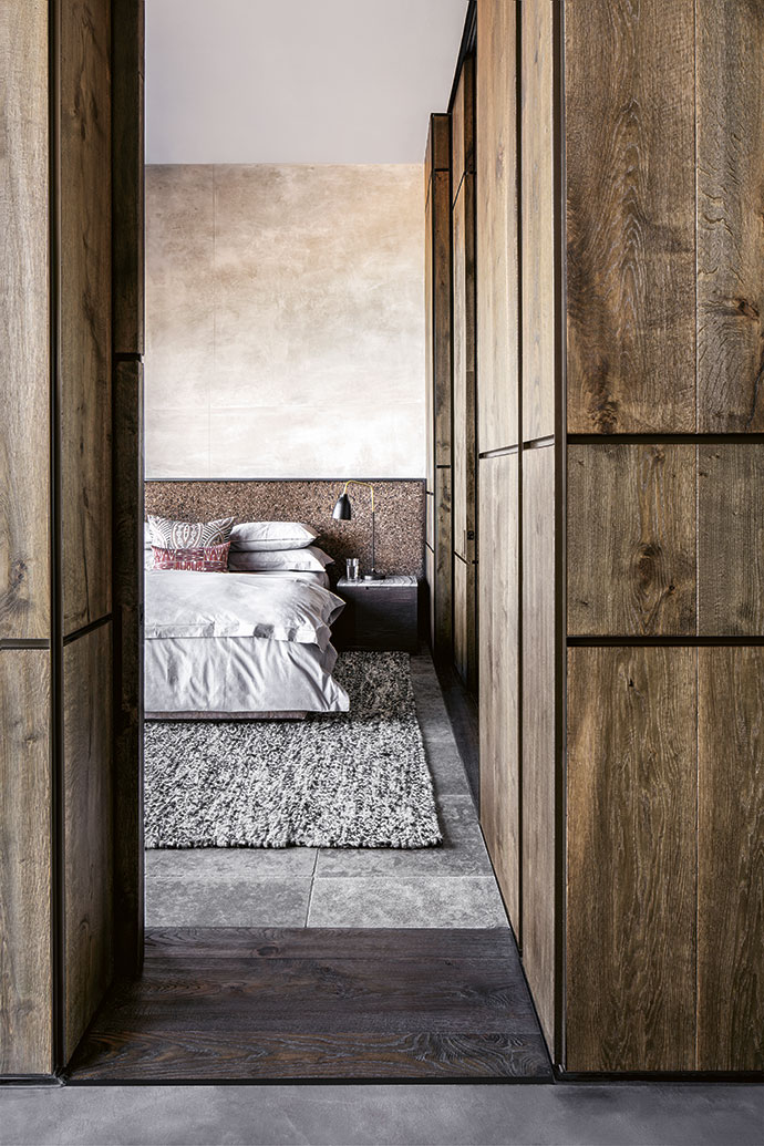 The guest bedroom on the lower level features a chocolate cork headboard that adds interesting texture to the space.