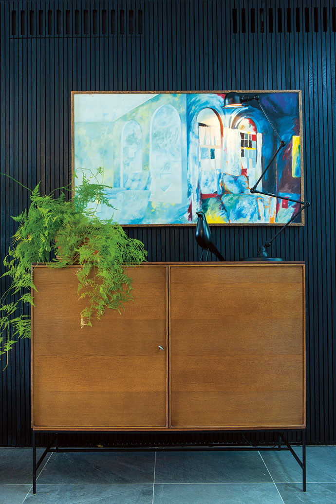 The drinks cabinet is an early piece by Tonic Design. On it rests a Vitra Eames House Bird and a Jieldé Signal SI433 lamp. The artwork is by Bradley's uncle, Clive van den Berg, painted when he was a student.