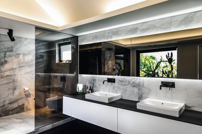 The master en-suite features acid-washed marble and matt black Meir taps from Flush Bathrooms.