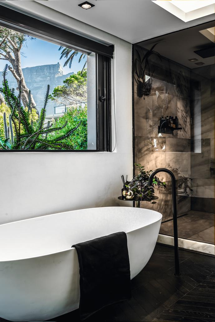 To layer the view from the master bathroom, Renato designed a larger planter that runs the width of the building's perpendicular middle box. Bradley has  filled it with cuttings from his visits to Babylonstoren's hotel and gardens, a place that is an ongoing source of inspiration to him.