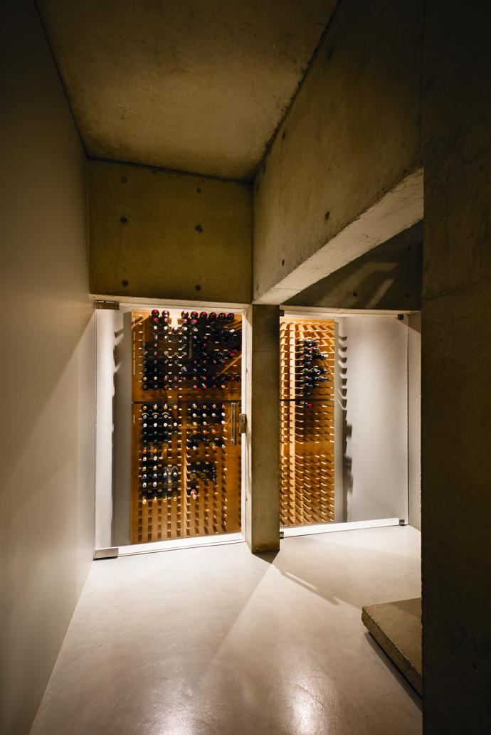 Albert's wine cellar is insulated from seasonal temperature fluctuations nestled between cool, concrete walls below ground.