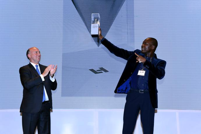 Francis Kéré receiving first LafargeHolcim Building Better Recognition 2017 for Middle East Africa at prize handover ceremony in Nairobi, Kenya