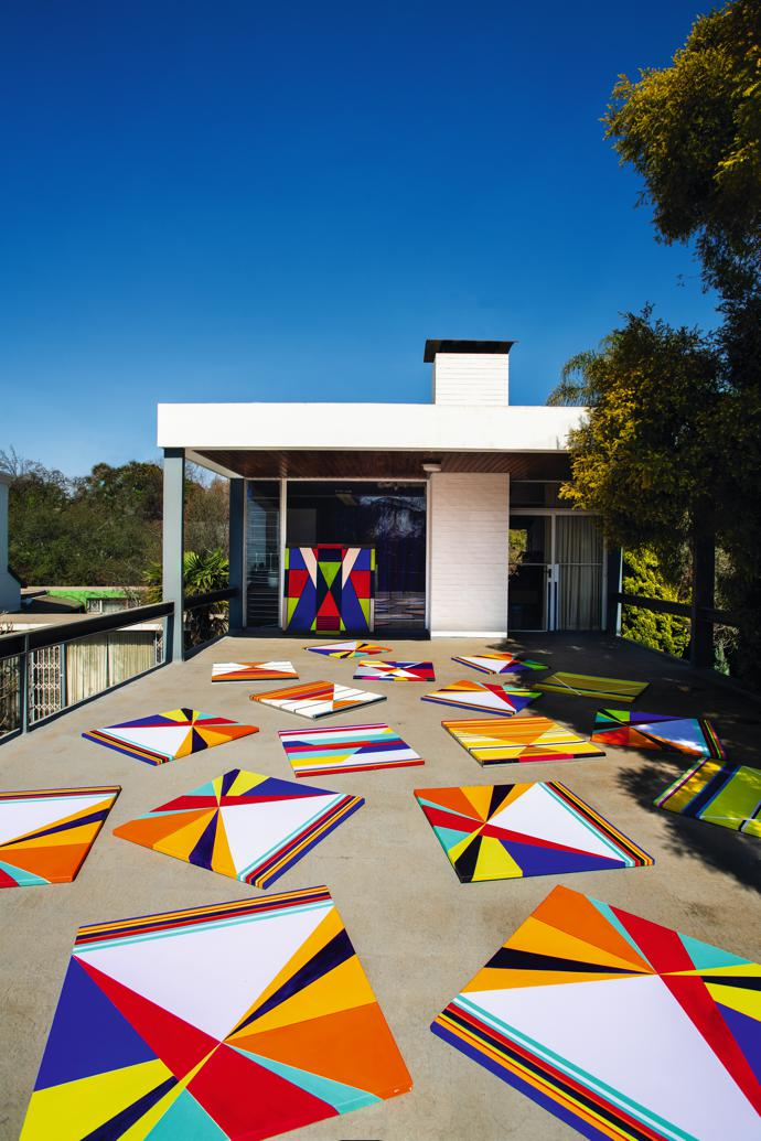 Owner Hannatjie van der Wat's geometric hard-edge paintings cover the terrace loading off her studio. Some of her works were inspired by her travels to Japan, while others were a sign of the times.