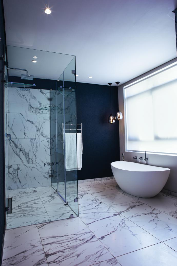 """Timeless quality and practicality"" was the aim for the bathrooms, featuring Calacatta marble tiles and fittings from Yourspace Bathrooms."