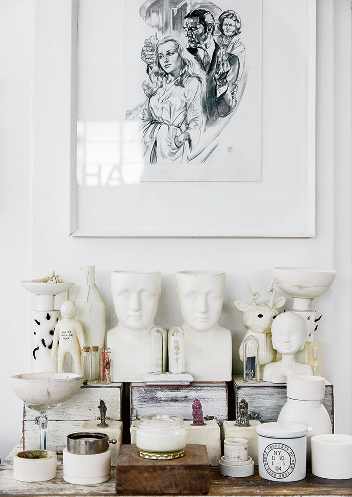 Grouping collectibles in shades of white and cream creates a calming effect. The artwork is an original Flip Coaton from around 1965.