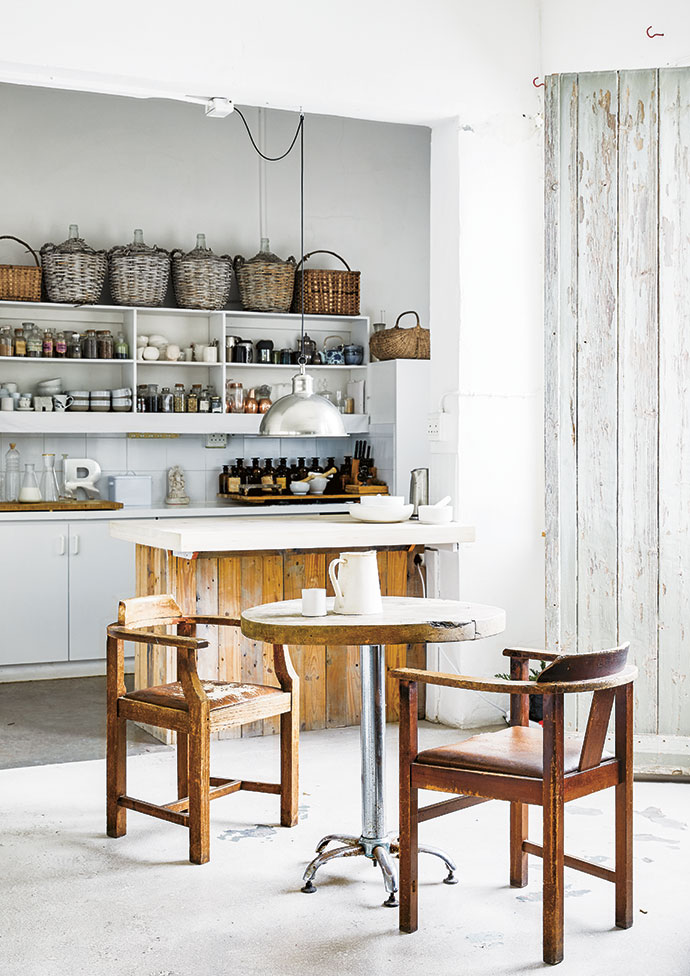 """Ideal for enjoying breakfast in front of the Bo-Kaap view are a wooden-topped café table and vintage chairs that """"have just always been around...""""."""