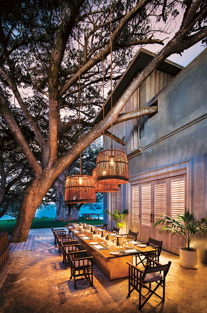 The outdoor dining veranda features a Fox Browne Creative table with built-in ice well for long, lazy lunches. In the evenings, the large basket lights reference local fishing baskets.