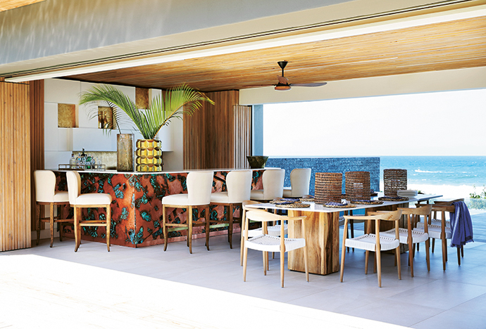 Fyfe Boyce designed the bar, a definite statement piece, and its copper panels were created and oxidised by artist Brendon Edwards. The bar stools are upholstered in an outdoor vinyl by Kravet, increasing their weather resistance.