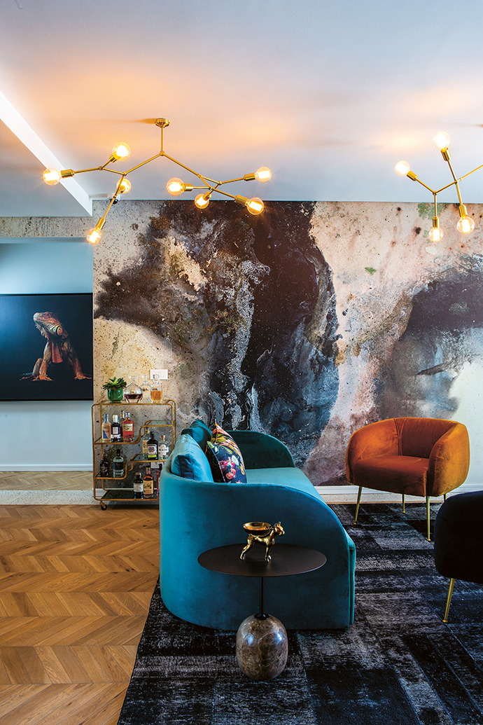 A mineral wallcovering in the lounge off the bar complements the jewel tones, warm gold, and timber and terrazzo finishes. Artworks by local artists were curated by owner David Ryan to deliver colour and drama.