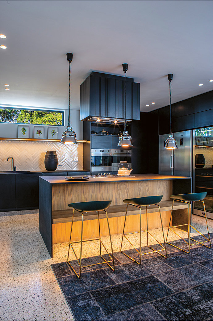 The open-plan kitchen is just off the atrium, which invites an easy informality.