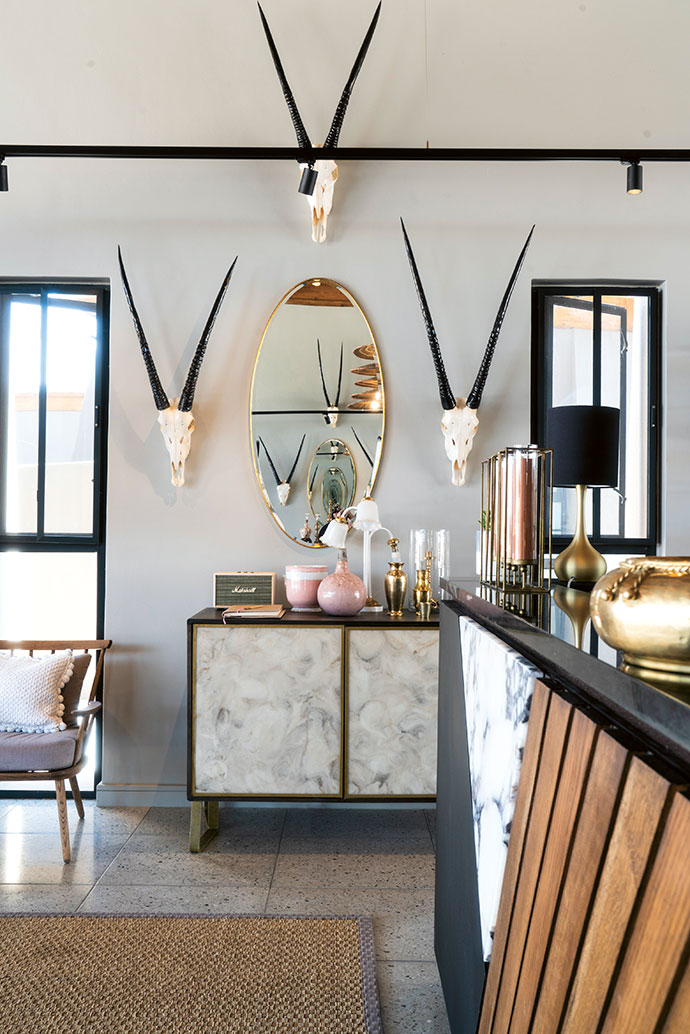 Oryx skulls from Ikhaya, offset by vintage bric-a-brac, set the tone in the guest reception area and boutique shop. The interior design and implementation was led by designer Sandy Tsou of Fox Browne Creative.